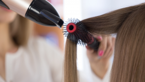 hairdresser blow drying hair